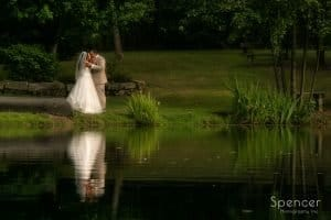 wedding picture of bride and groom by pond at Country Cottage and Gardens