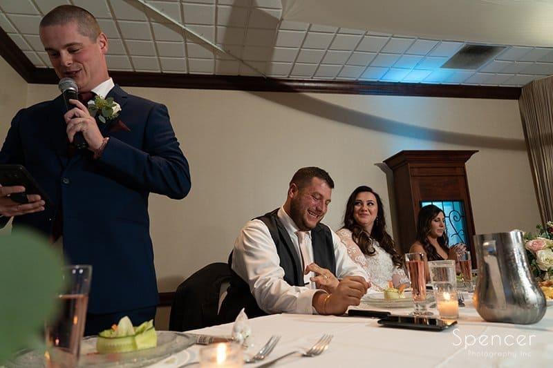 groom reacting to best man speech a wedding reception at LaMalfa
