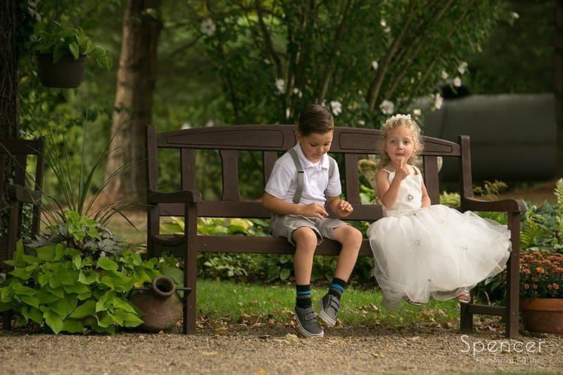 kids sidtting on bench at Country Cottage and Gardens