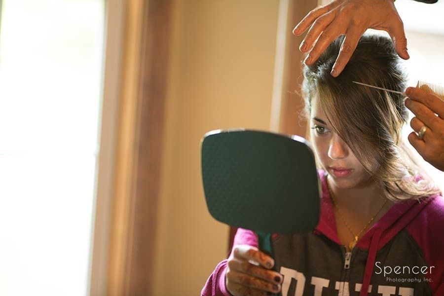 Muslim bridesmaid getting hair done