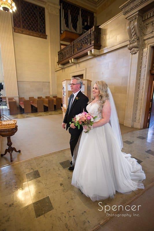 bride and dad entering wedding ceremony at Communion of Saints Parish