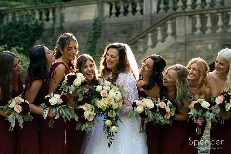 bride laughing with bridesmaids after wedding in Mayfield Ohio