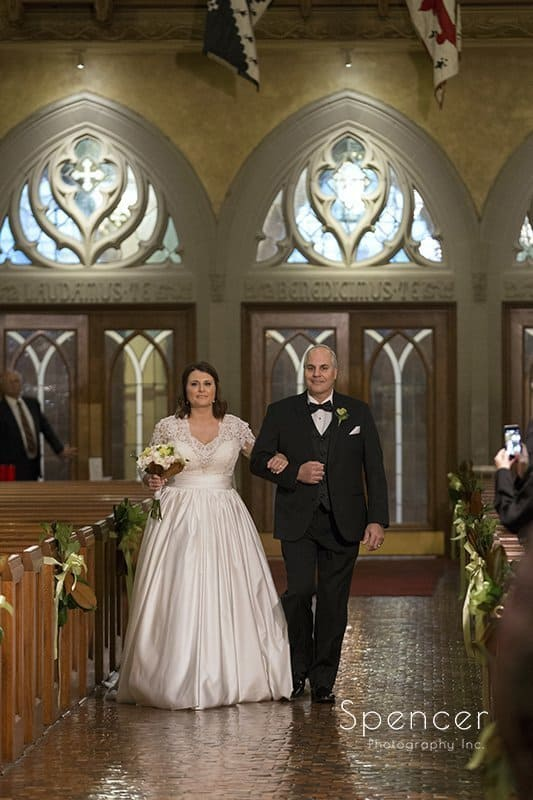 dad walking bride down aisle at Cathedral of St John the Evangelist