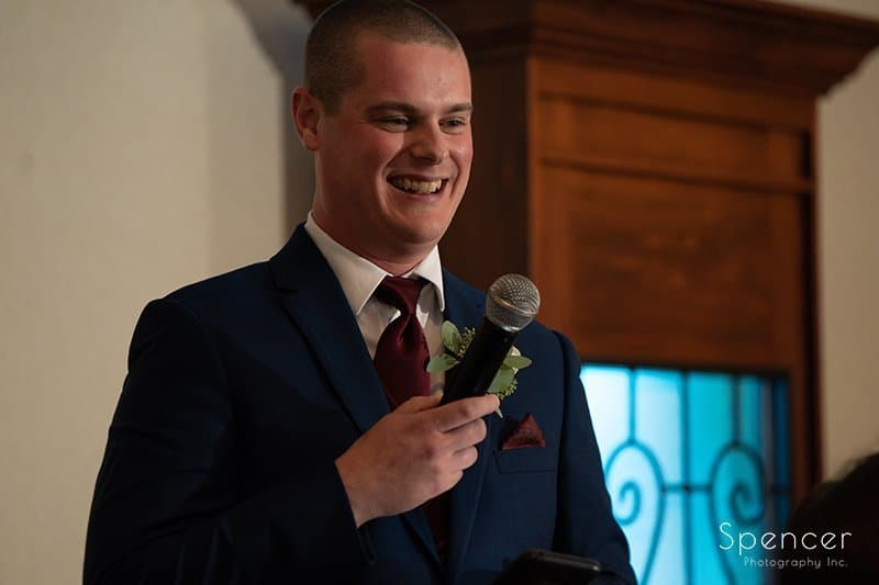 best man smiling during is reception speech at LaMalfa