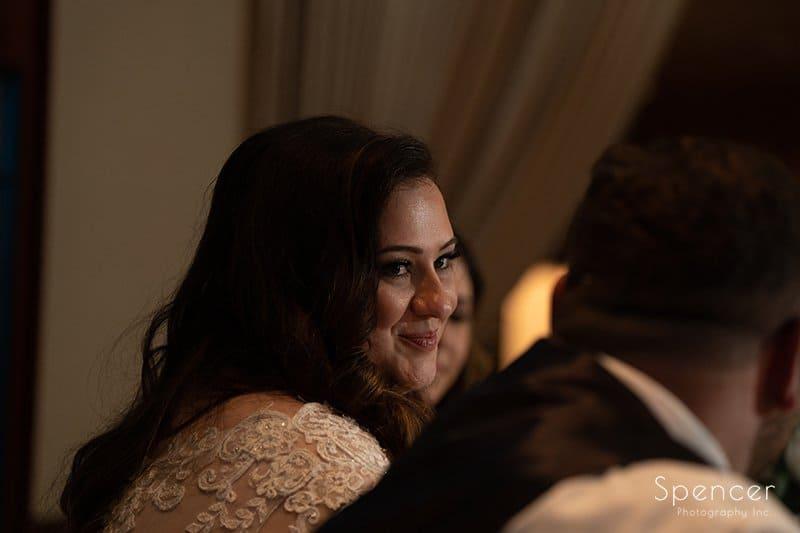 bride grinning at groom at LaMalfa wedding reception