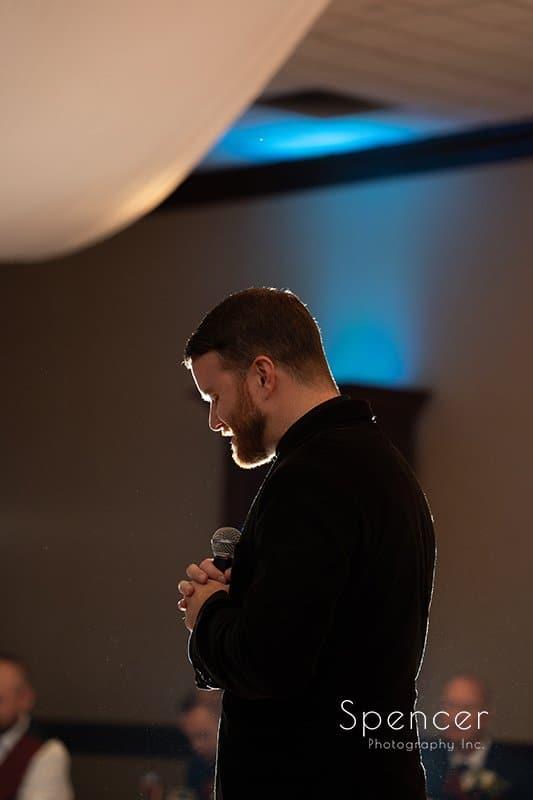 priest praying at wedding reception at LaMalfa