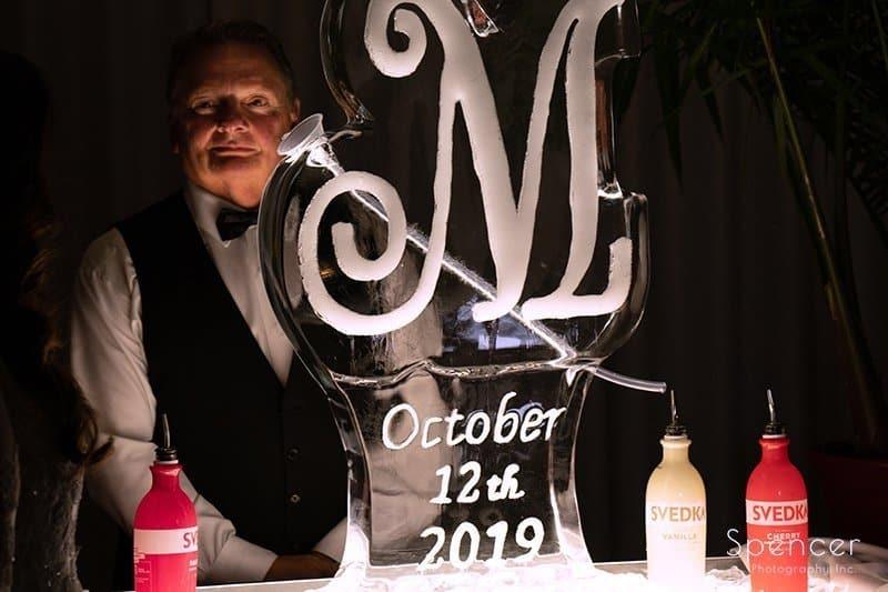 LaMalfa bartender standing by wedding reception ice sculpture