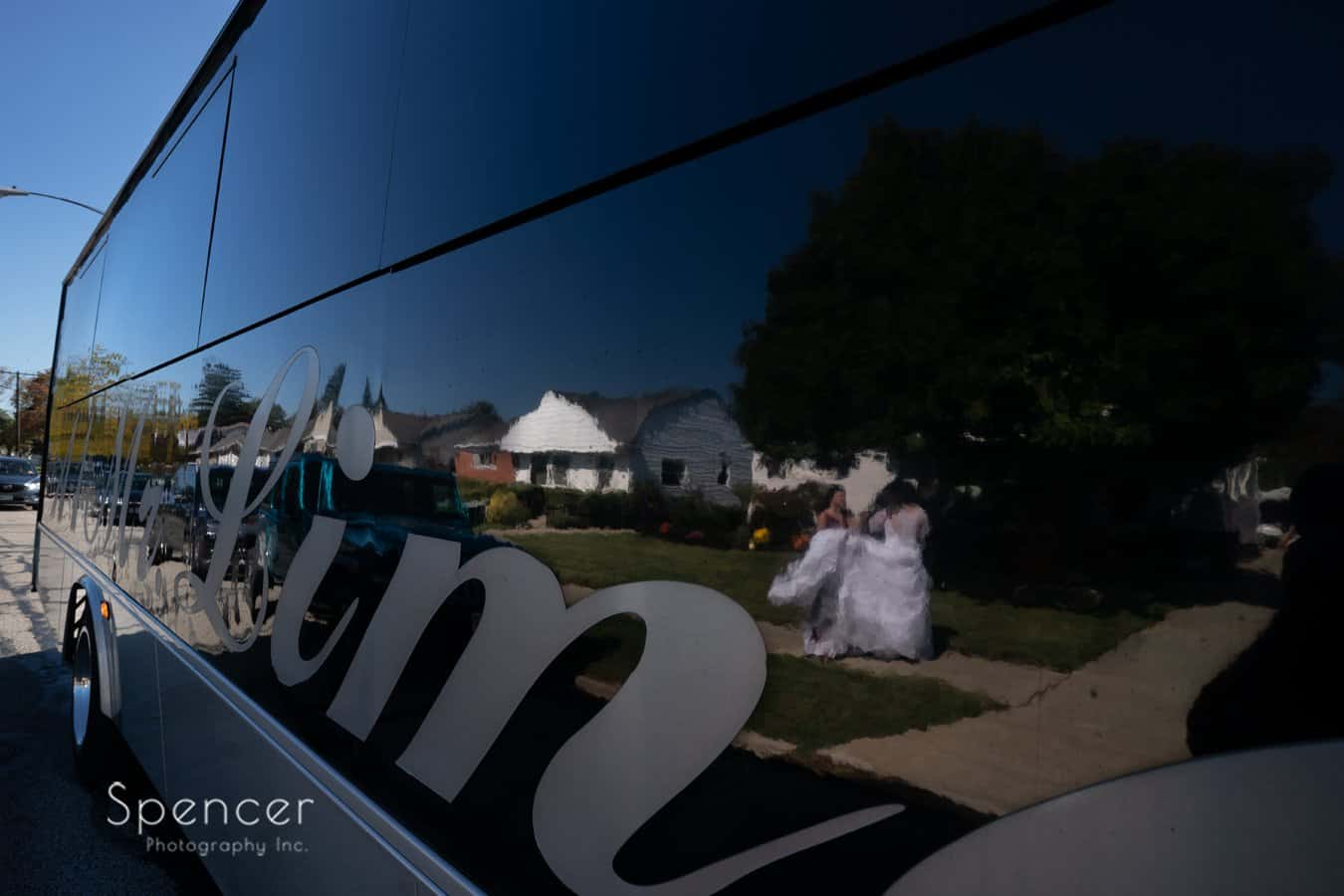 reflection of bride in limo bus