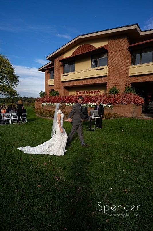bride and groom recess after their wedding ceremony at Firestone