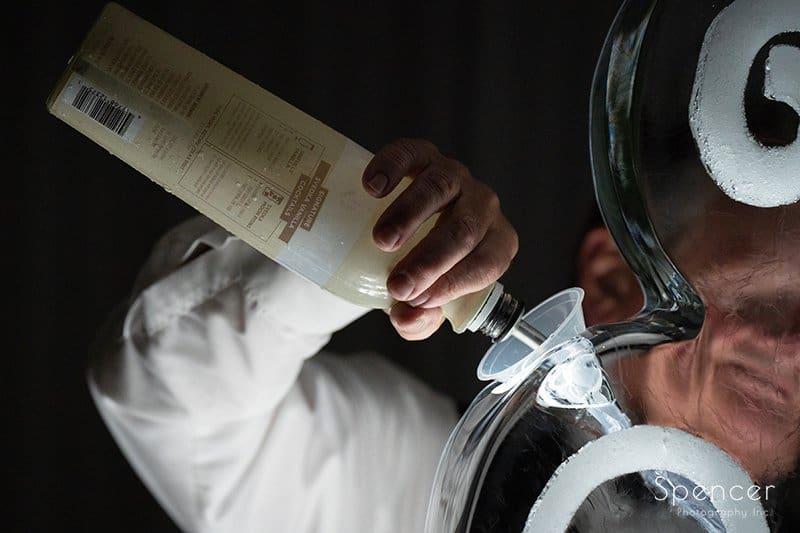 bartender pouring drink at LaMalfa wedding reception