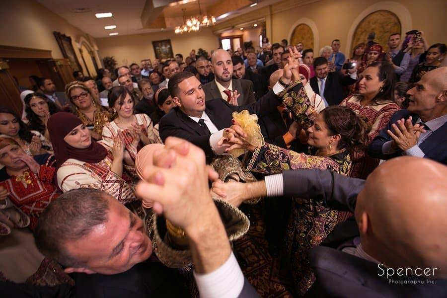 groom dancing at his Muslim wedding reception