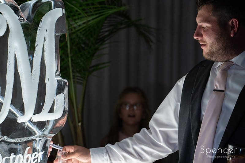 groom getting drink at LaMalfa wedding reception