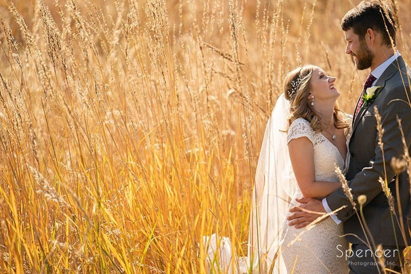 bride and groom in tall grass on Firestone Golf Course