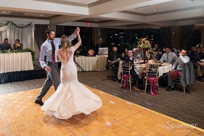 horizontal picture of bride and groom dancing