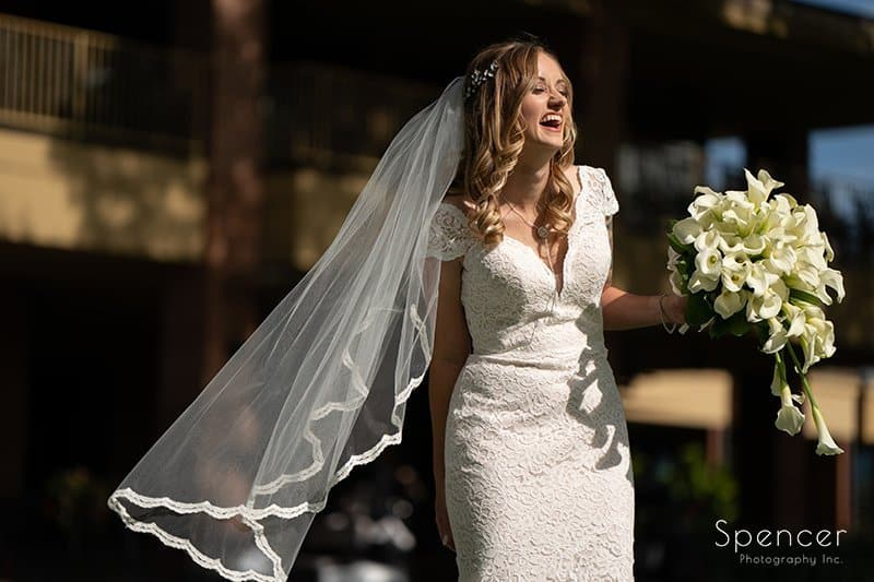 bride holding flowers laughing at fall wedding in akron ohio