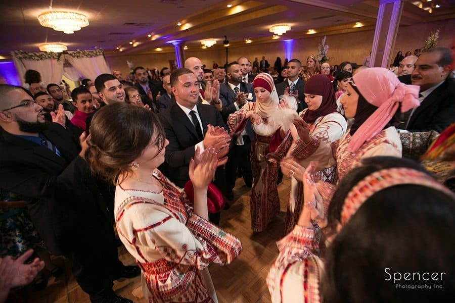 room dancing with wedding guests at his Muslim reception