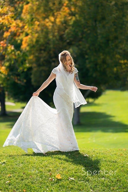 bride walking with wedding dress at fall wedding in akron ohio
