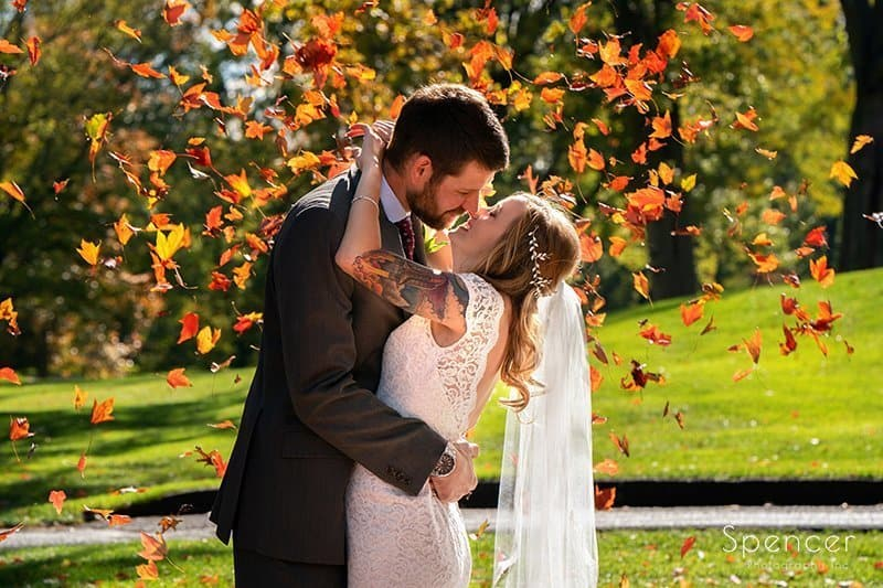 fall wedding picture of bride and groom at Firestone