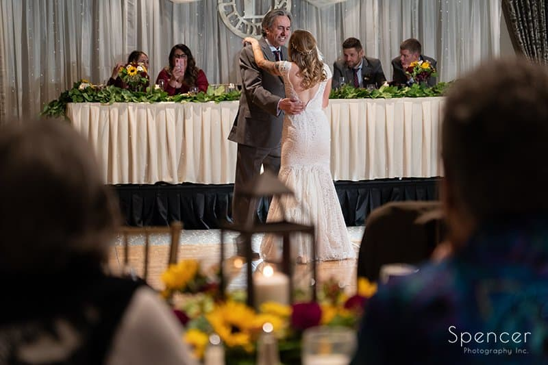 father dancing with bride and firestone wedding reception