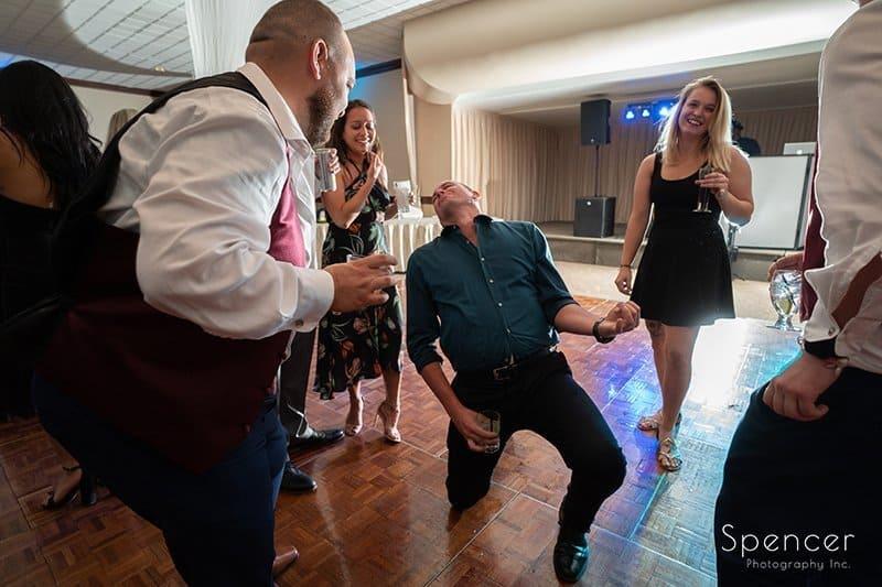 man plays air guitar at wedding reception at LaMalfa