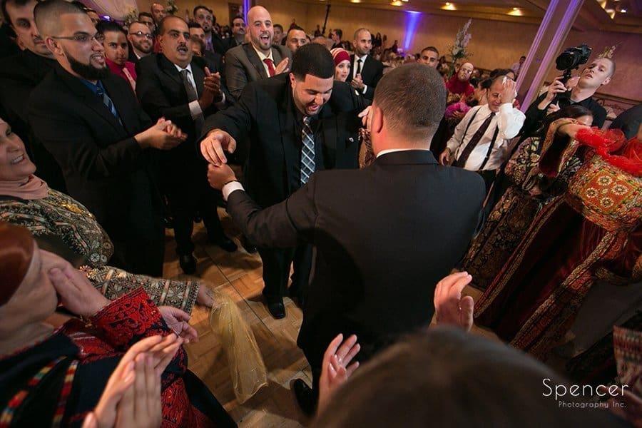 wedding guest dancing with groom