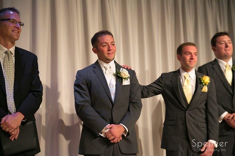 best man comforts groom at wedding at Cuyahoga Valley Church