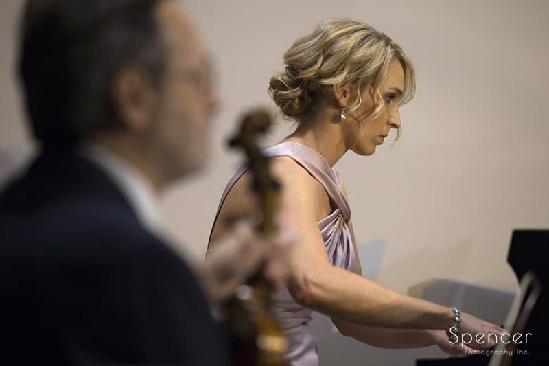 bridesmaid plays piano at Canton wedding ceremony