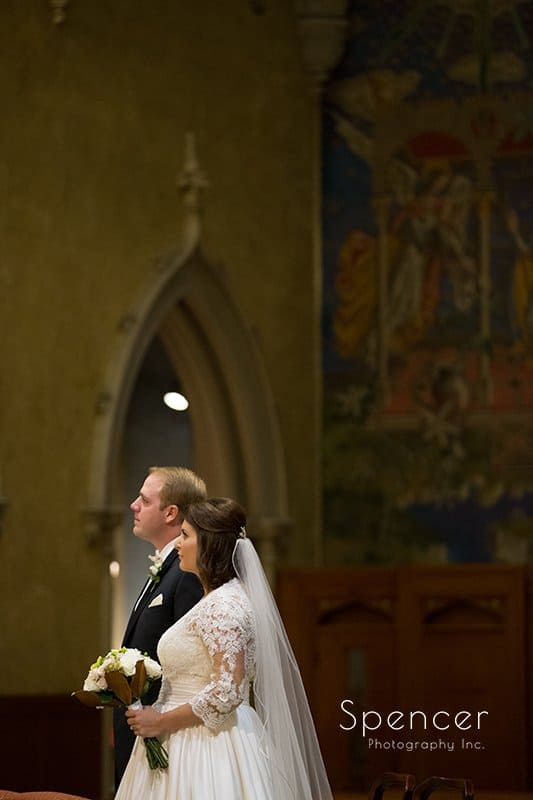 groom and bride at wedding altar at Cathedral of St John the Evangelist