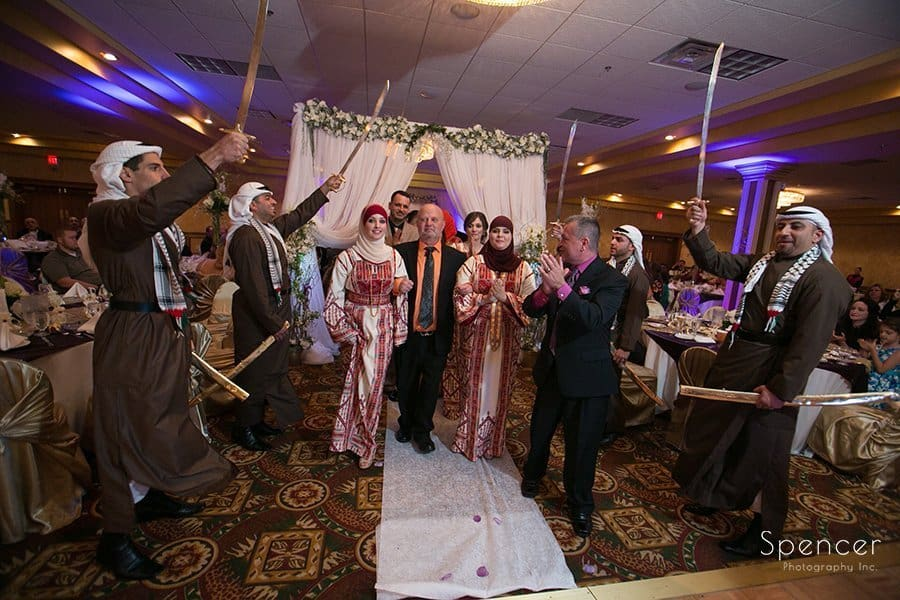 family members enter Muslim wedding reception