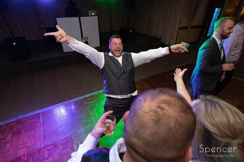 groom having fun at his wedding reception at LaMalfa