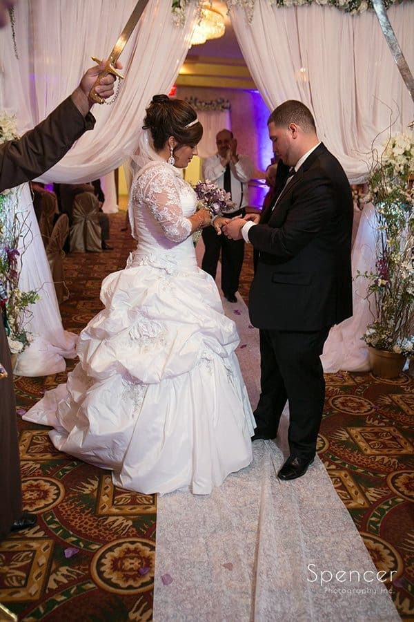 bride and groom greet each other at Muslim wedding reception