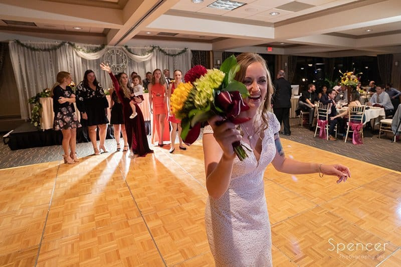 bride getting ready to throw reception bouquet at Firestone