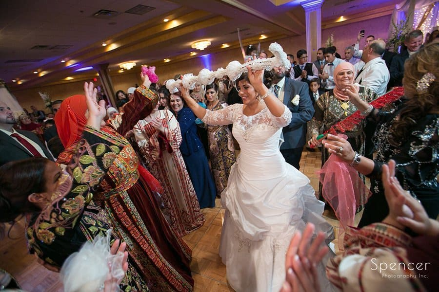 Muslim bride dances at her wedding reception