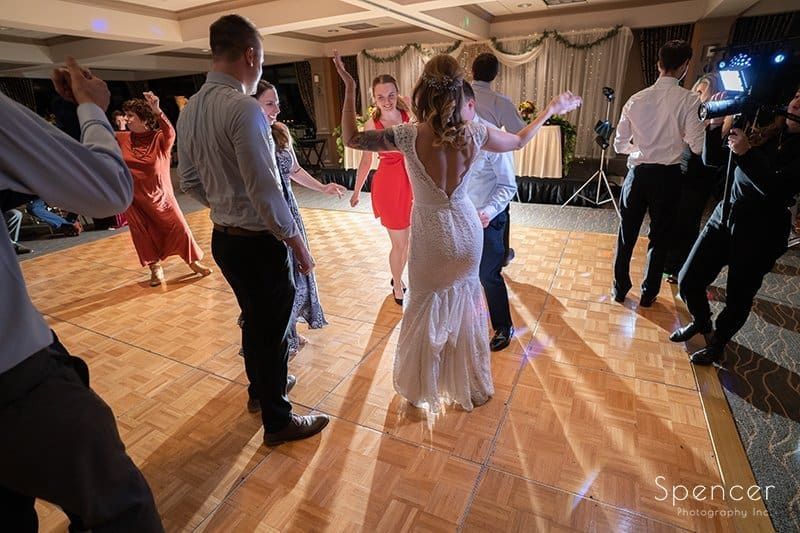 bride dancing at her wedding reception at Firestone Country Club
