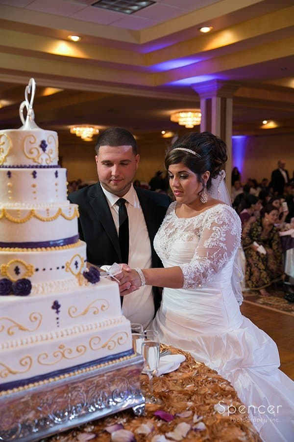 bride and groom cutting their wedding cake at La Villa