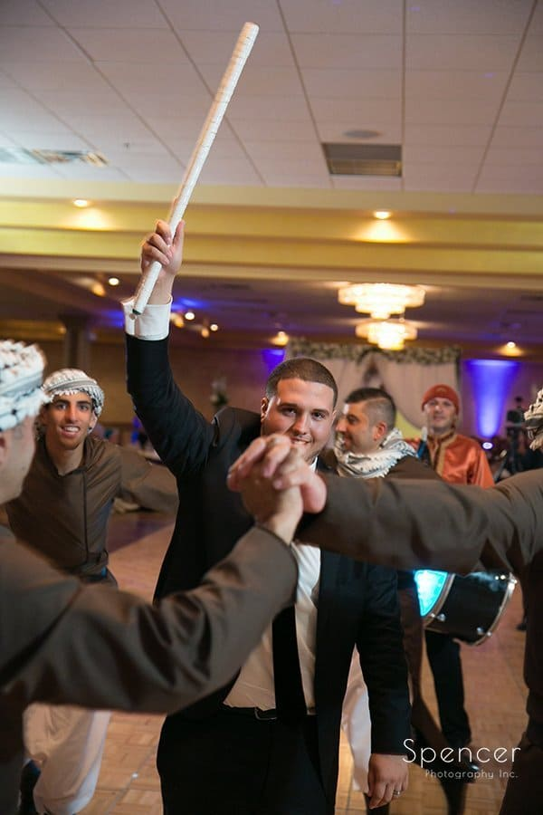 groom conducting Muslim wedding tradition