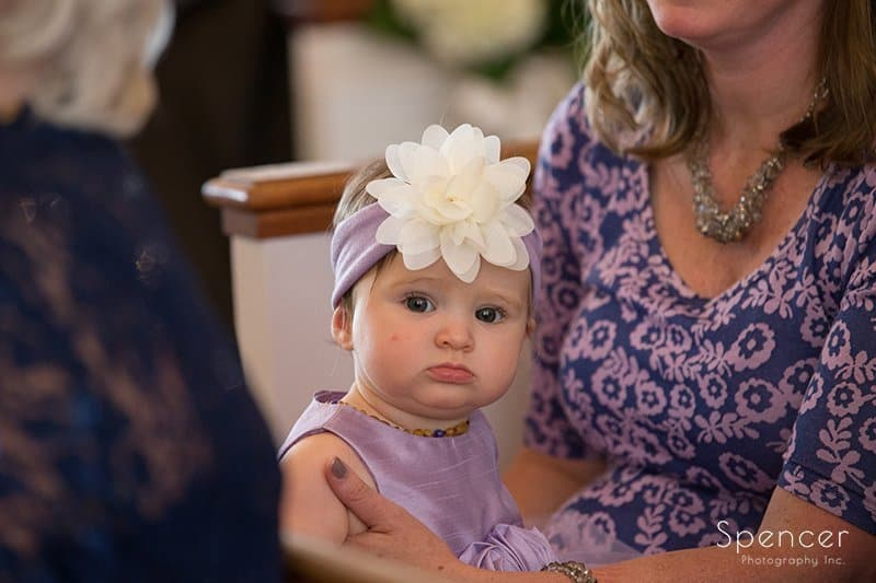 flower girl at wedding ceremony at Church on the Lakes