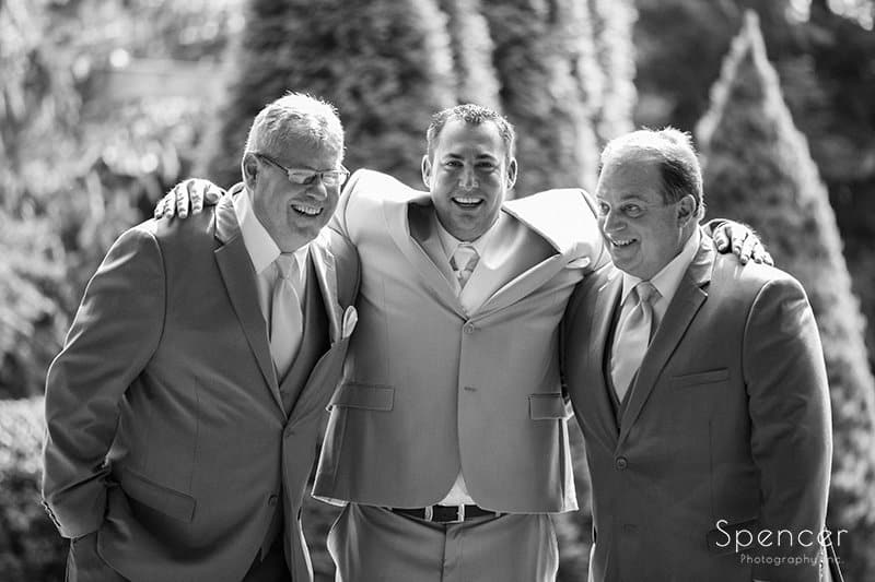 groom with dads at wedding at Country Cottage and Gardens
