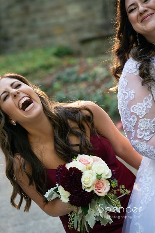 maid of honor laughing hilariously with bride