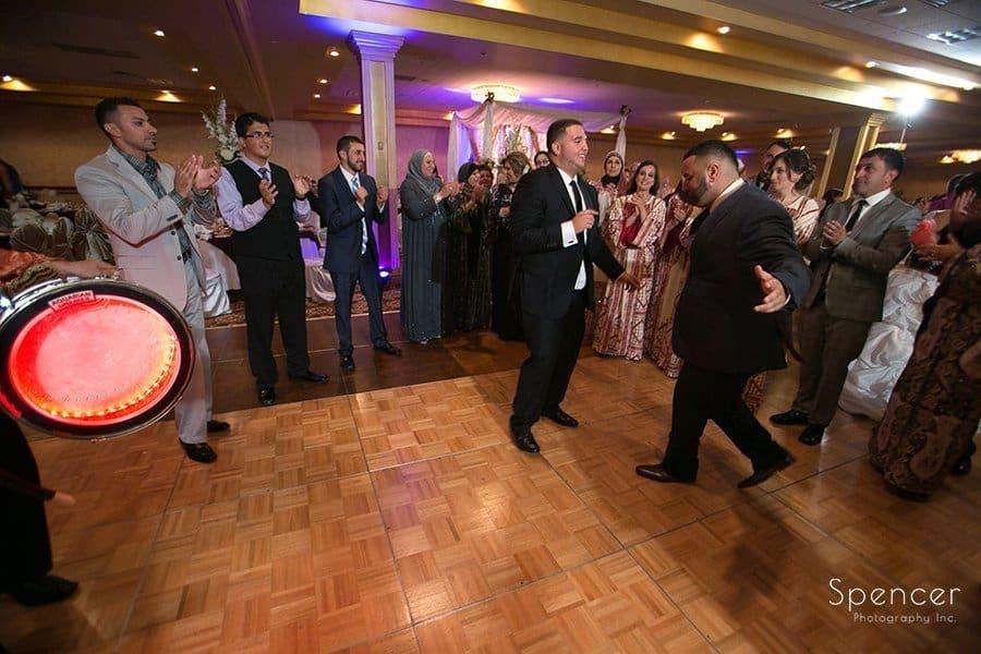 men dancing at wedding reception at La Villa