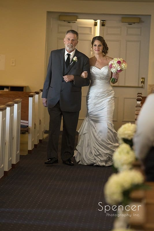 dad walking bride down wedding aisle at Church on the Lakes