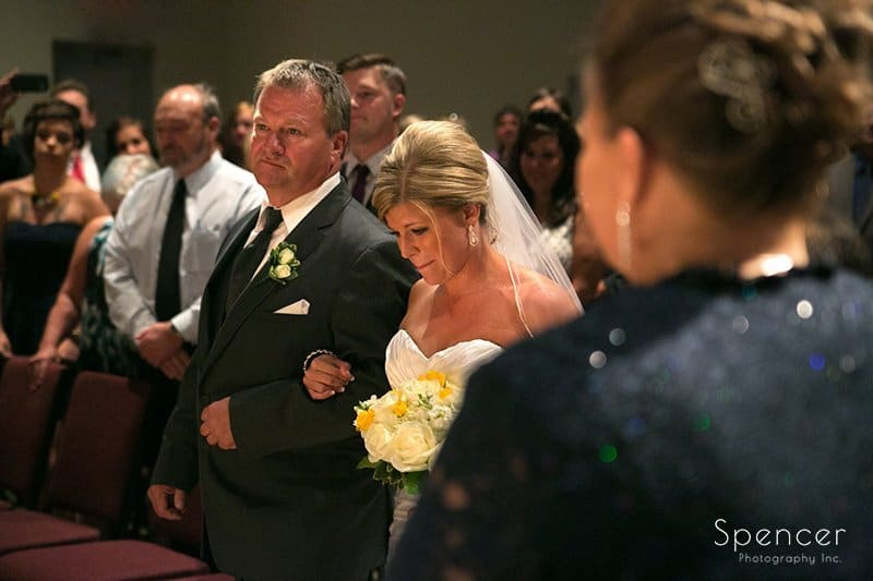 dad walks bride to wedding altar at Cuyahoga Valley Church