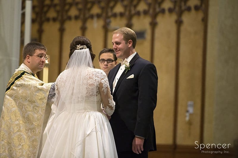 groom looking at bride during wedding at Cathedral of St John the Evangelist