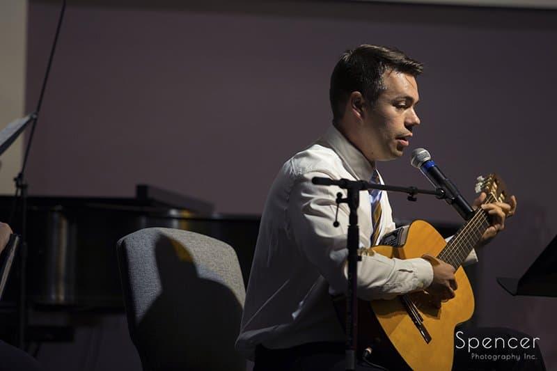 musician playing guitar at Canton wedding