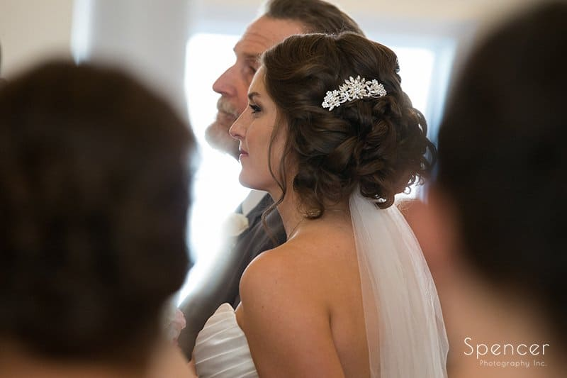 Bride standing at aisle at Church on the Lakes Canton Ohio