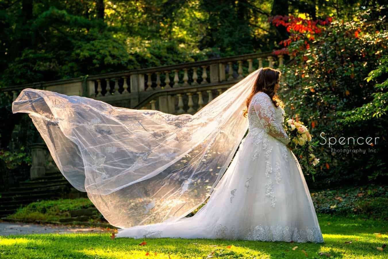 cleveland bride with blowing veil holding flowers