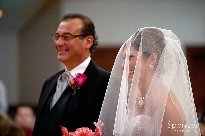 father walks bride to ceremony at Cornerstone Church Medina