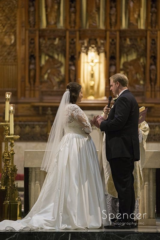 full lenght picture of bride and groom during wedding at Cathedral of St John the Evangelist