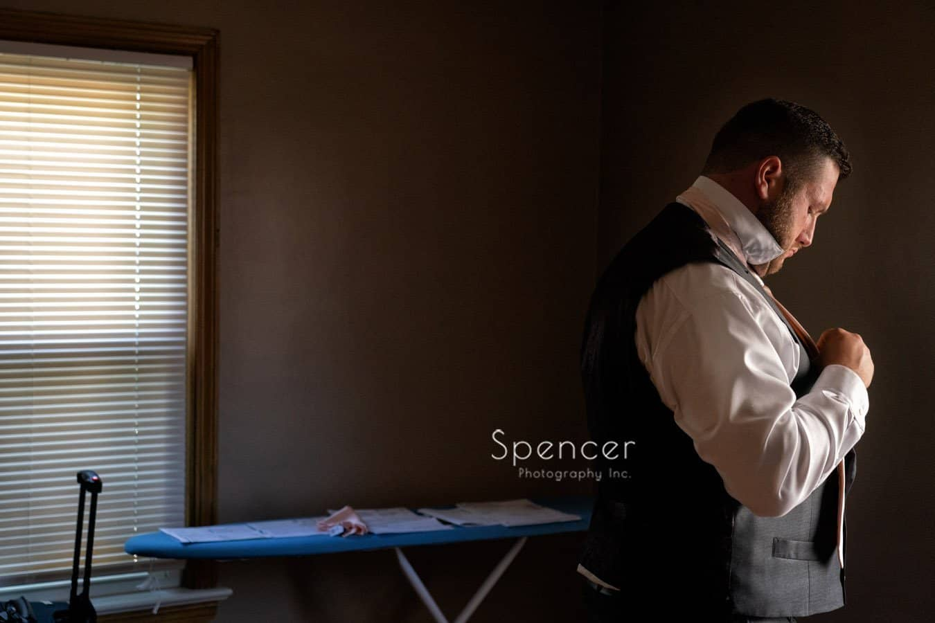 groom getting dressed for his wedding in Mayfield Ohio