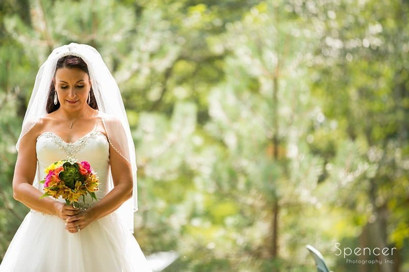 wedding picture of bride holding bouquet at Country Cottage and Gardens